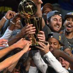The Golden State Warriors celebrate winning the 2015 NBA Finals on June 16, 2015 at the Quicken Loans Arena in Cleveland, Ohio.  Steph Curry and Andre Iguodala each scored 25 points as the Golden State Warriors captured their first NBA title in 40 years by defeating Cleveland 105-97 to win the NBA Finals.  AFP PHOTO  / TIMOTHY A. CLARY        (Photo credit should read TIMOTHY A. CLARY/AFP/Getty Images)