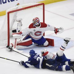 Jun 30, 2021; Tampa, Florida, USA; Tampa Bay Lightning center Blake Coleman (20) scores a goal past Montreal Canadiens goaltender Carey Price (31) and left wing Phillip Danault (24) during the second period in game two of the 2021 Stanley Cup Final at Amalie Arena. Mandatory Credit: Douglas DeFelice-USA TODAY Sports