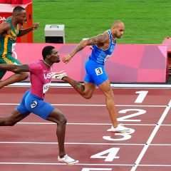 Tokyo 2020 Olympics - Athletics - Men's 100m - Final - OLS - Olympic Stadium, Tokyo, Japan - August 1, 2021. Lamont Marcell Jacobs of Italy crosses the finish line first to win the gold medal REUTERS/Aleksandra Szmigiel