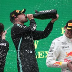 epa09516698 Winner Finnish Formula One driver Valteri Bottas of Mercedes-AMG Petronas (C) and second placed Dutch Formula One driver Max Verstappen (R) of Red Bull Racing celebrate with champagne on the podium during the award ceremony of Formula One Grand Prix of Turkey at the Intercity Istanbul Park circuit in Istanbul, Turkey, 10 October 2021.  EPA/SEDAT SUNA