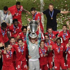 LISBON, PORTUGAL - AUGUST 23: Manuel Neuer, captain of FC Bayern Munich lifts the UEFA Champions League Trophy following his team's victory in the UEFA Champions League Final match between Paris Saint-Germain and Bayern Munich at Estadio do Sport Lisboa e Benfica on August 23, 2020 in Lisbon, Portugal. (Photo by Manu Fernandez/Pool via Getty Images)